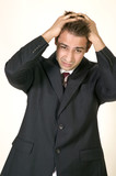 Young Caucasian man in business suit suffering stress poster