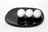 boiled eggs on  black plate
