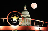 star of texas with the state capitol building at night poster