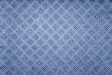 blue colored metal patterned background.