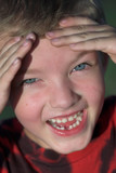 smiling boy with tooth missing poster