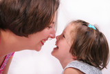 mother and daughter rubbing noses poster