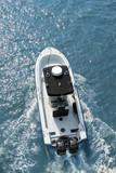 motorboat racing across water, overhead view poster