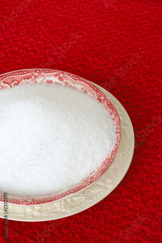 bowl of sugar on a red placemat