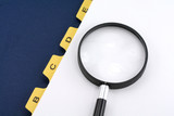 yellow file divider and magnifier poster