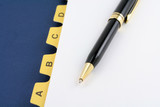 yellow file divider and pen poster