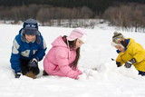 kids building a snow fort poster
