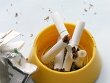 dirty ash-tray and broken last cigarettes poster