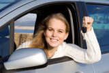 woman with new car and key