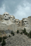 mount rushmore under stormy skies poster