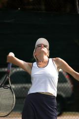 beautiful woman serving tennis