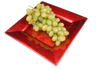 green grapes on a red plate