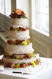beautiful four tiered wedding cake poster