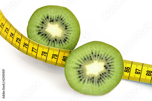 sliced kiwi and measuring tape