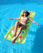 attractive, slim young lady lying on inflatable su
