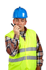 construction worker talking with a walkie talkie