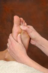 reflexologist therapeutic foot massage