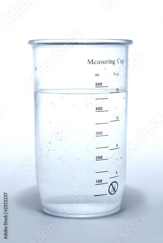measuring cup on white