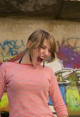 girl shouting loud on urban background