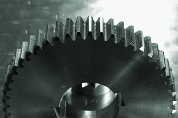 large gear shot against lightsource