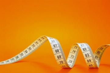 measuring tape on orange