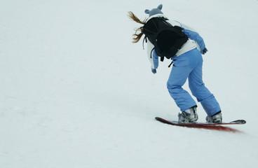 riding snowboarder