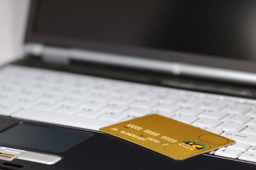 gold credit card and notebook