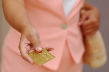 woman with a gold credit card