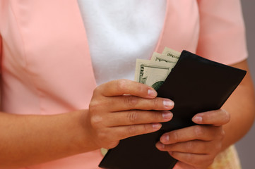 woman with money and a wallet