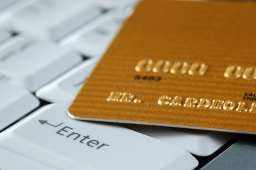 gold credit card on a keyboard