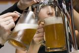 filling of beer mugs. poster