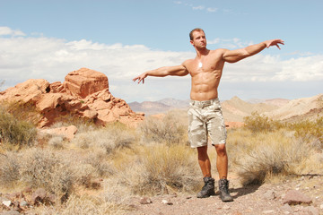 muscular man in shorts hiking