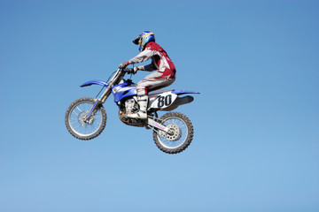 dirt bike jumping in the air