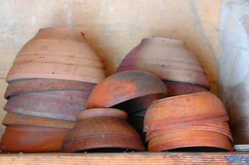 old clay bowls in a traditional wine cellar of the azores island