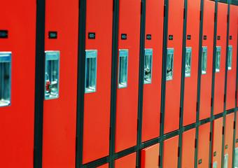 a row of orange lockers