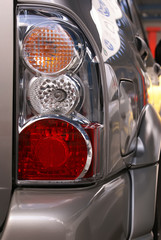 Car hedlight close-up. Turn, stop and reverse signals.