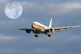 airplane flying in early evening with full-moon poster