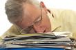 exhausted senior businessman