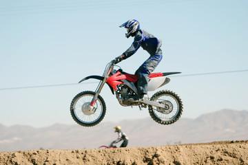 dirt bike jumping on the air
