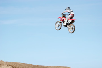 motorcycle jumping high in the air
