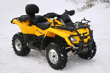 the yellow cross-country vehicle.