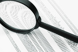 magnifying glass and business data poster