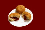 doughnuts with jam of raspberry on plate. confecti poster