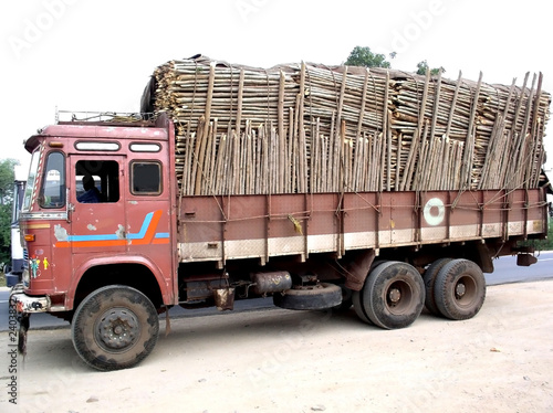 poster of old truck carrying full load of woods