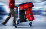 man with red bags at the airport - Fine Art prints