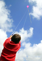 child flying kite.