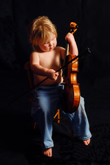 toddler playing violin