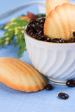 biscuits and coffee beans on blue napkin poster