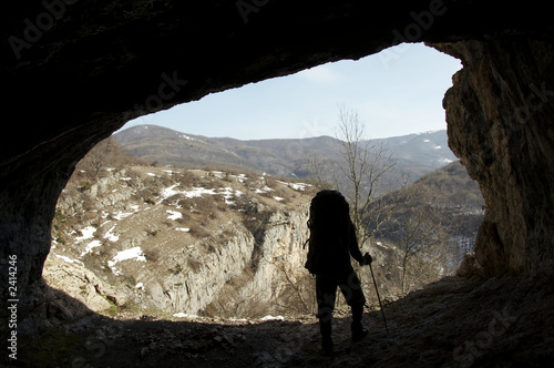 hiker silhouette in grotto