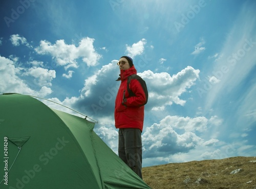 man in red jacket about tent